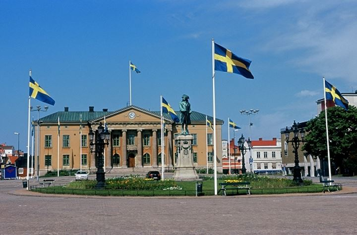 Building with Swedish flags and statue