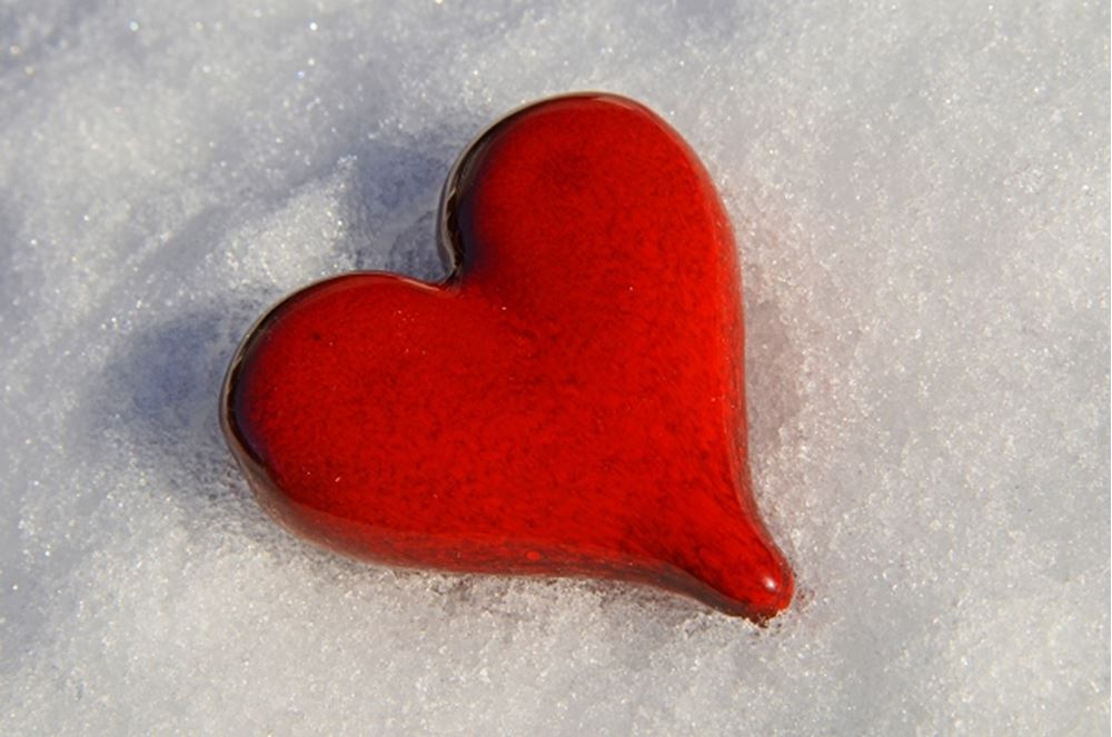 Plastic heart in the snow