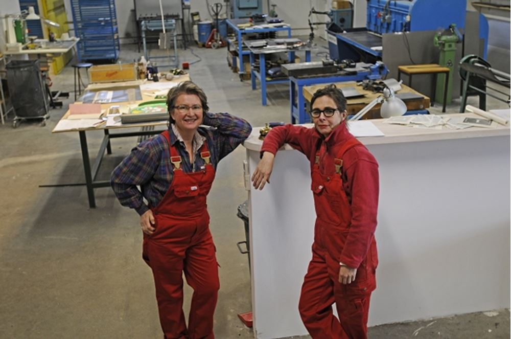 Two woman with red working clothes