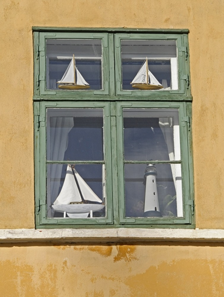 Window with sailsboats and lighthouse