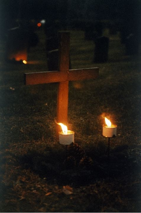 Lit candles in a grave