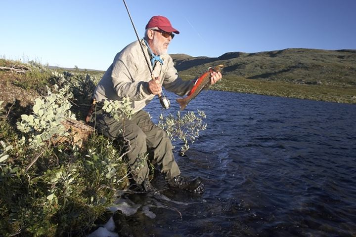A man cathing a char  in Lapland, Sweden