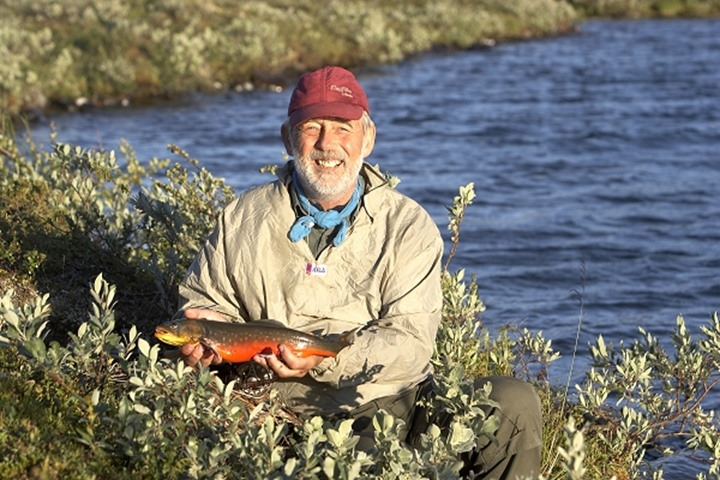 A happy man, just catched a char in Lapland, Sweden
