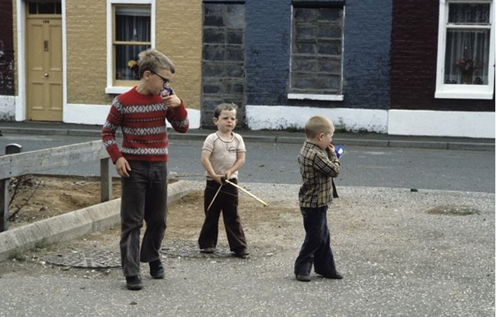 Three children playing outdoors