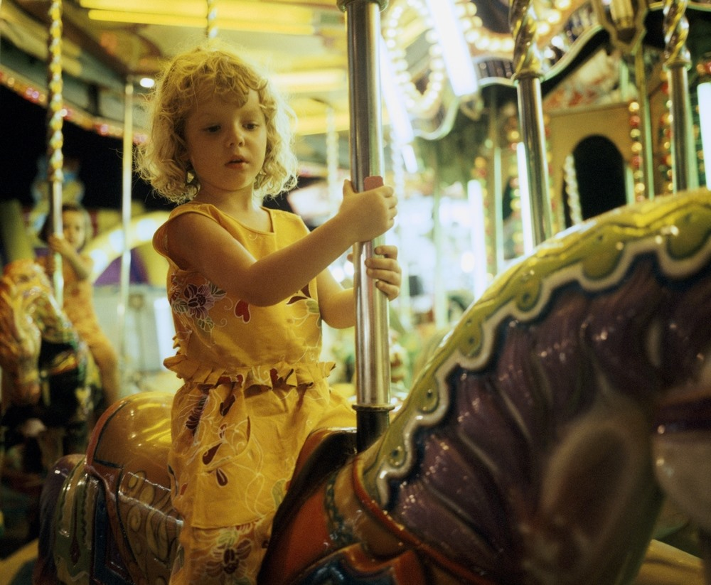 A girl on a merry-go-round