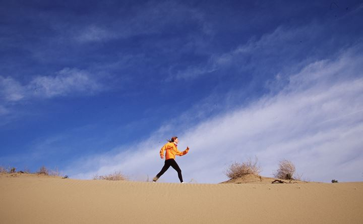 A woman walking in a desert