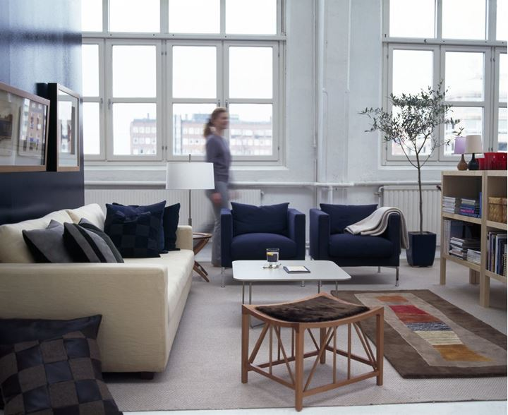A woman walking in the living room of an apartment