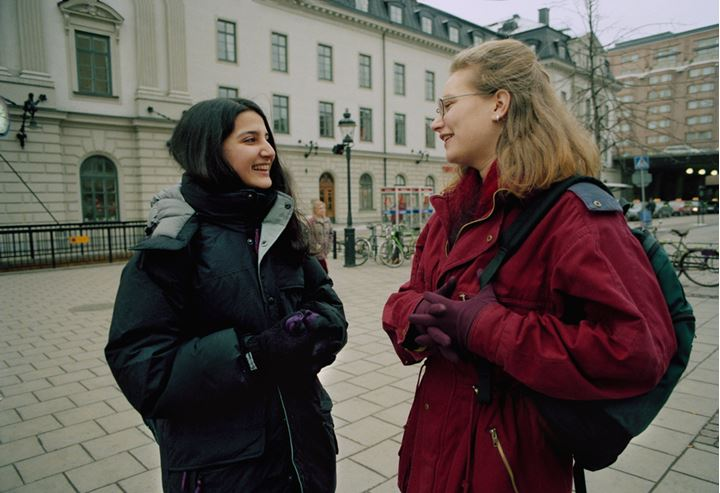 Friends meeting outdoors in Stockholm