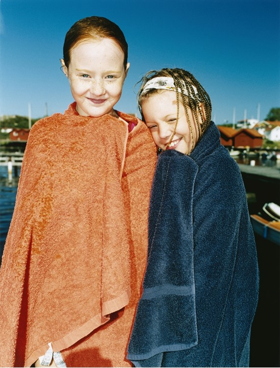 Two girls wrapped themselves in towels
