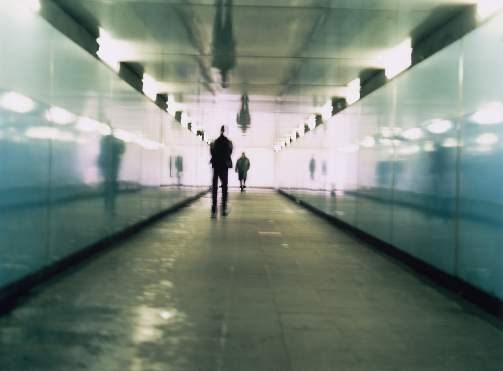 Two people in a corridor