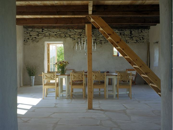 Dining room with stone walls and floor, Gotland, Sweden